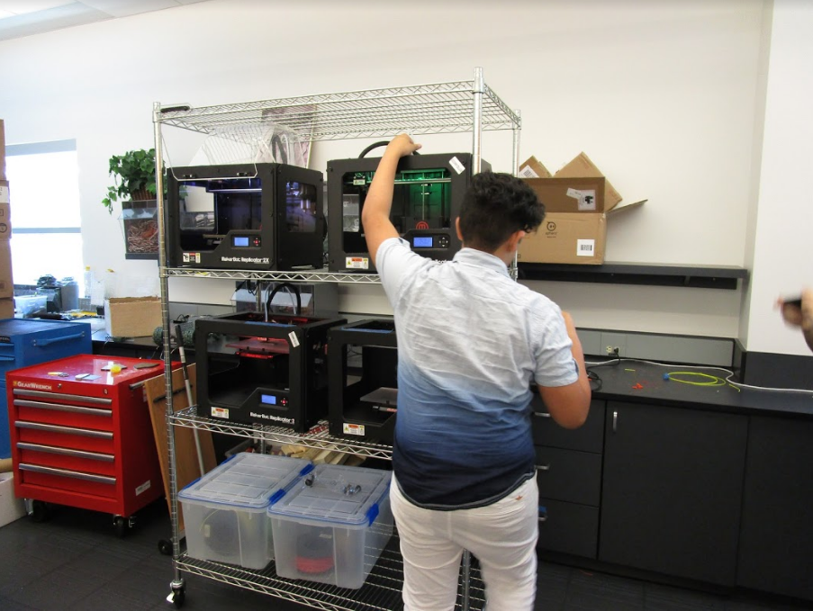 Intern Adrian preparing the MakerBot 3D printers.