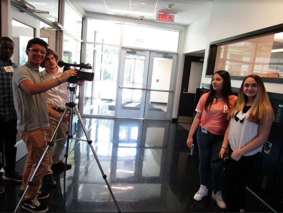Interns Robert, Kaylani, and Dzenita filming a promotional video.